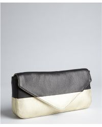 Pour La Victoire Gold and Black Leather Adele Long Clutch - Lyst