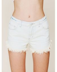 Free People Dolphin Hem Denim Cut Off - Lyst