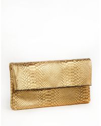 Juicy Couture - Jade Snake Embossed Leather Clutch - Lyst
