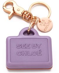 See By Chloé Suitcase Keychain purple - Lyst