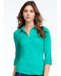 Bebe Patch Pocket Jersey Button Up Blouse - Lyst
