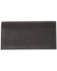 Alexander McQueen Studded Leather Travel Wallet - Lyst