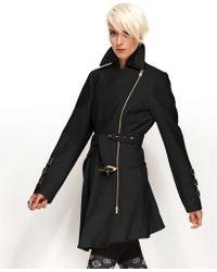 Bebe Coat Asymmetrical Belted Trench Coat - Lyst