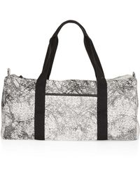 TOPSHOP - Black Forest Luggage Bag - Lyst
