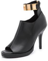 Shakuhachi - Metal Ankle Booties - Lyst