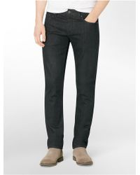 Calvin Klein Jeans Slim Leg Tinted Dark Rinse Jeans black - Lyst