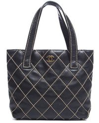 Chanel Pre-Owned Lambskin Small Surpique Tote Bag - Lyst