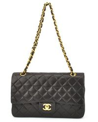 Chanel Pre-owned Black Quilted Lambskin Medium Flap Bag - Lyst