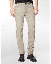 Calvin Klein Slim Straight Faded Neutral Jeans - Lyst