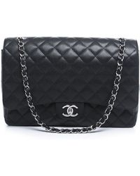 Chanel Pre-Owned Black Caviar Maxi Double Flap Bag black - Lyst