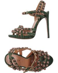 Alaïa Sandals green - Lyst