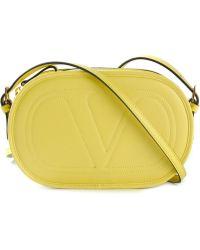 Valentino Logo Embossed Crossbody Bag - Lyst