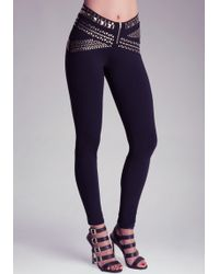 Bebe Heavy Metal Belted Leggings - Lyst