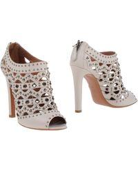 Alaïa White Shoe Boots - Lyst
