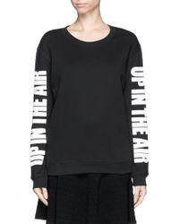 Sandro Timi Slogan Print Sleeve Sweatshirt - Lyst