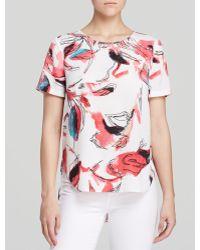 DKNY High Low Short Sleeve Bird Print Top - Lyst