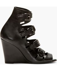 Surface To Air Black Leather Buckle Wedge Sandals - Lyst