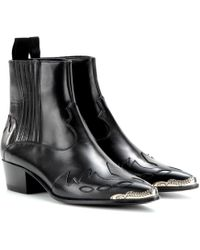 Saint Laurent Duckies Western Leather Ankle Boots - Lyst