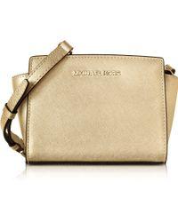 Michael Kors | Pale Gold Metallic Saffiano Leather Selma Mini Messenger Bag | Lyst