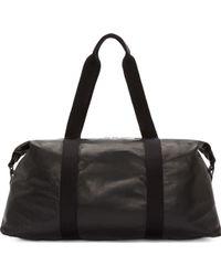 Alexander McQueen - Black Leather Duffle Bag - Lyst
