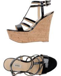 Guess Sandals black - Lyst