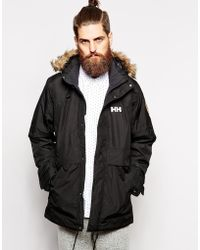Helly Hansen Parka With Insulation And Faux Fur Hood black - Lyst