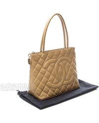 Chanel Preowned Beige Caviar Medallion Tote Bag - Lyst