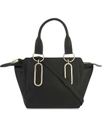 Ala?a Midi Tote Wristlet Bag in Black | Lyst