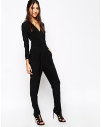 Never Fully Dressed - Deep Plunge Neck Jumpsuit With Wrap Front - Lyst