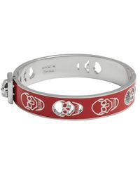 Alexander McQueen Red And Silver Pierced Skull Bangle red - Lyst