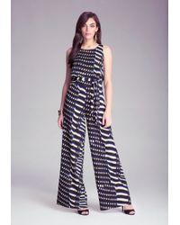 Bebe Print Tie Waist Jumpsuit - Lyst