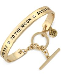 BCBGeneration - Gold-tone Word Bangle Bracelet - Lyst