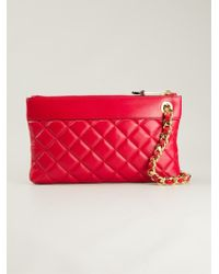 Moschino Quilted Clutch Bag - Lyst
