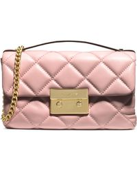 Michael Kors Sloan Quilted Leather Small Messenger pink - Lyst