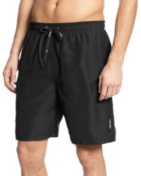 Calvin Klein Solid Swim Trunks - Lyst