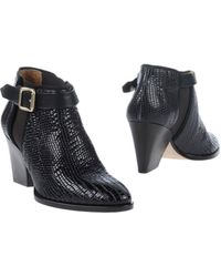 Zoe Lee Black Ankle Boots - Lyst