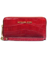 MICHAEL Michael Kors Leather Large Multi-Function Phone Case red - Lyst