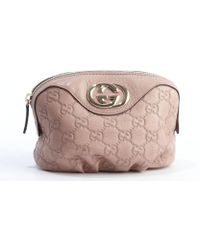 Gucci Dark Powder Pink Gg Stamped Leather Pouch - Lyst