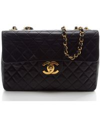 Chanel Preowned Black Lambskin Maxi Flap - Lyst