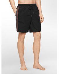 Calvin Klein White Label Piped Swim Trunks black - Lyst