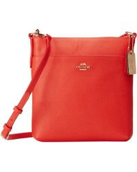 Coach Emb Txt Leather Ns Swingpack red - Lyst