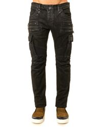 Balmain Multi Pocket Distressed Biker Jeans - Lyst