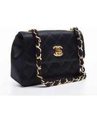 Chanel Pre-owned Black Quilted Satin Vintage Mini Flap Bag - Lyst