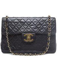 Chanel Black Lambskin Maxi Flap Bag - Lyst