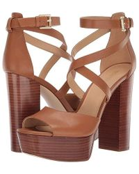 37075c64c8 Michael Kors Cicely Patent-leather And Cork Wedge in Metallic - Lyst