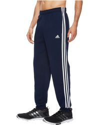 2dd797b8d Lyst - adidas Essentials 3 Stripes Tapered Fleece Trousers in Blue ...