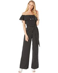 752b49bda86a Lyst - Bebe Cold Shoulder Ruffle Lace Jumpsuit in Black