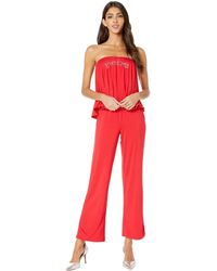 8044896a1e79 Lyst - Bebe Logo Denim Knit Jumpsuit in Blue