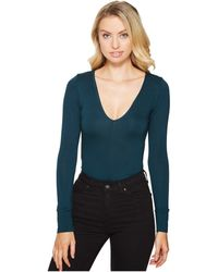 Lucy Love - Deep V Bodysuit - Lyst