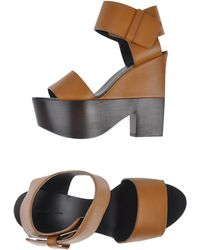 Celine Sandals brown - Lyst